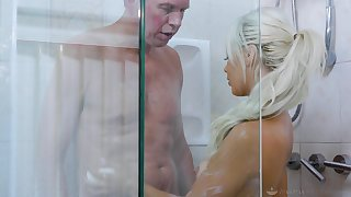 Sexy sitter Elsa Jean gives a blowjob and nuru rub down to married man