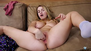 Cute loving babe with a ripened body masturbating on be transferred to couch